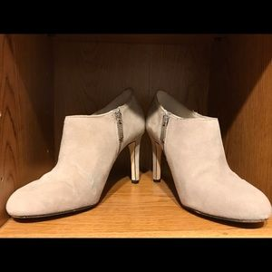 Light gray heeled booties with side zip.